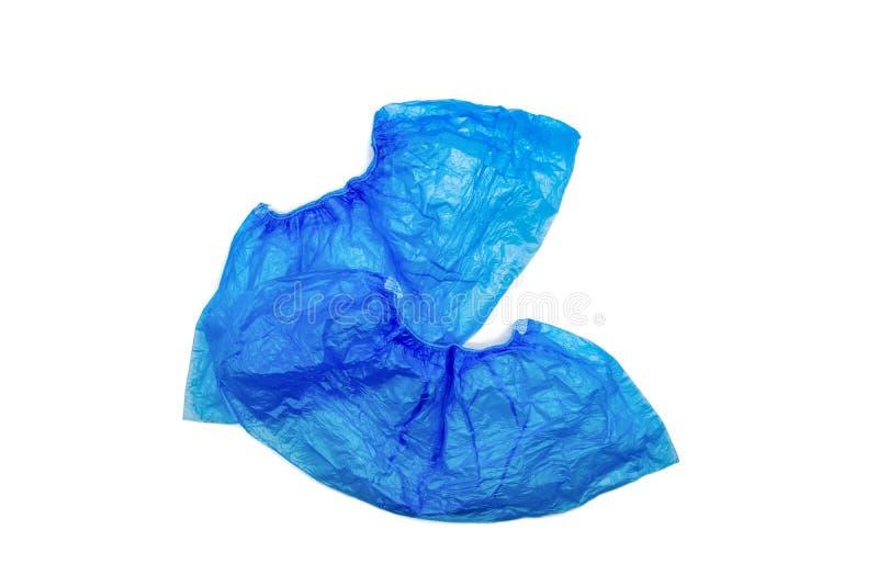 La chaussure deux bleue médicale couvre des couvre-chaussure d'isolement sur le fond blanc photos stock
