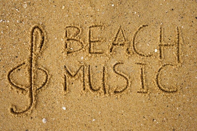 La chiave ed il testo di musica tirano la musica in secco attinta una sabbia fotografie stock libere da diritti