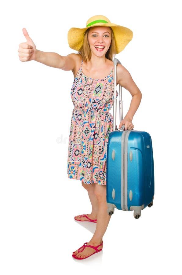 La chica joven con los pulgares del estuche de viaje para arriba aislados en blanco fotografía de archivo