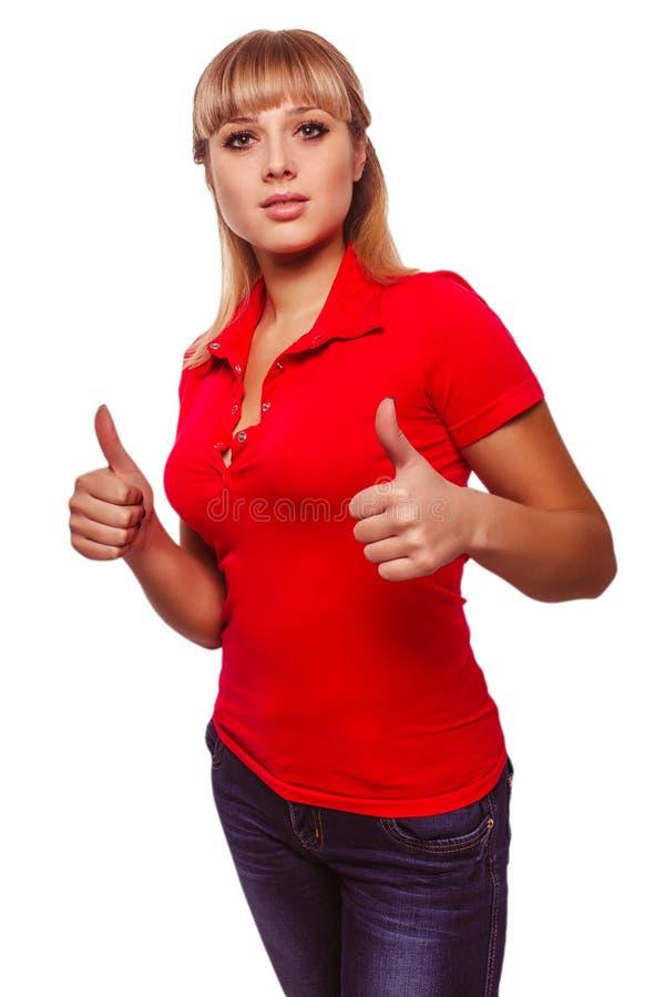 La chica joven feliz de la mujer muestra un signo positivo imagen de archivo