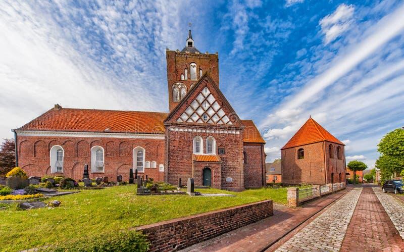 La chiesa trasversale in Pilsum fotografie stock libere da diritti