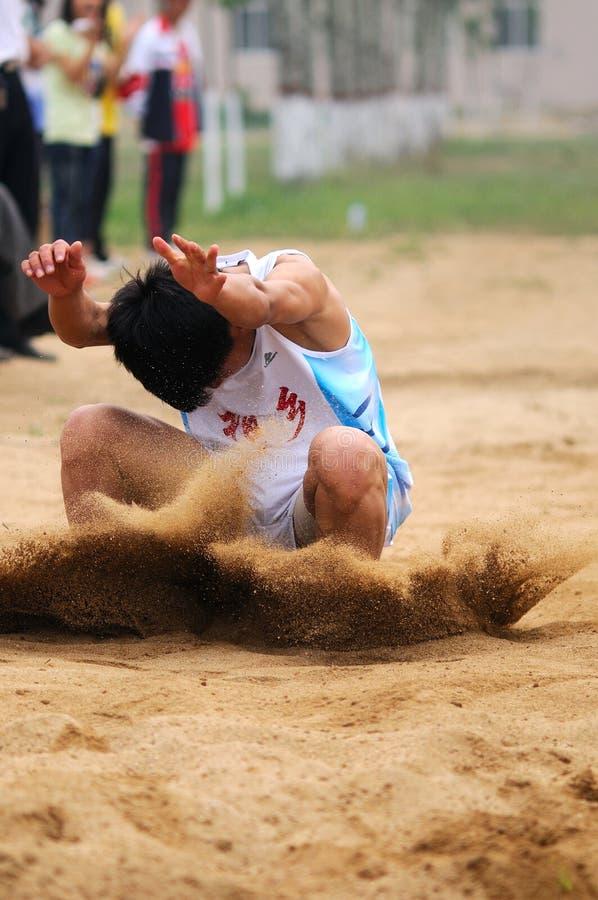 La Chine : Jeux d'athlétisme d'étudiant/long saut photographie stock libre de droits