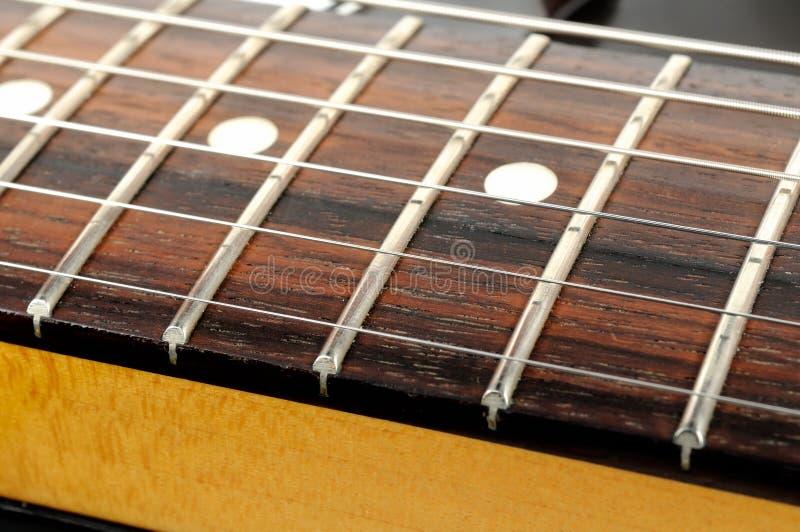 La chitarra elettrica mette insieme il primo piano fotografie stock libere da diritti
