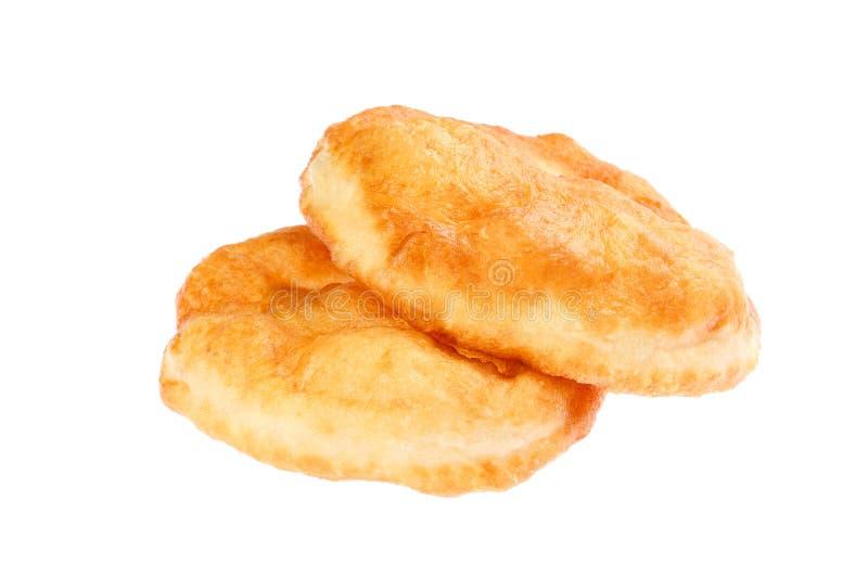 La ciambella bulgara tradizionale gradisce la prima colazione, nominata Mekitsa o Mekica, isolato su fondo bianco Mekitsa è fatto fotografia stock libera da diritti