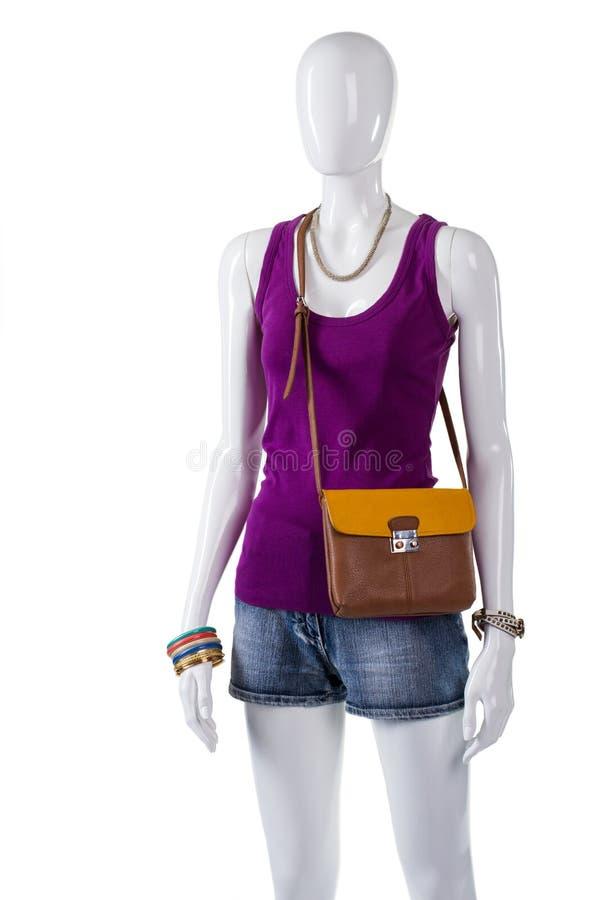 La cima e la borsa bicolore della donna fotografia stock