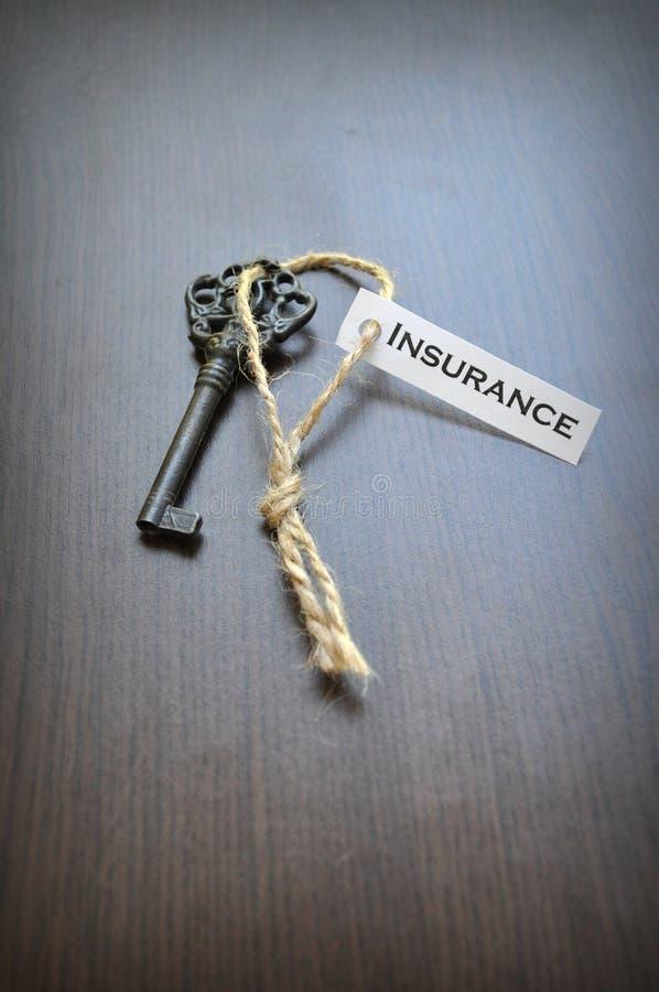 La clé à l'assurance photo stock