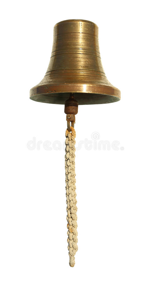 La cloche en laiton est située sur un fond blanc photographie stock
