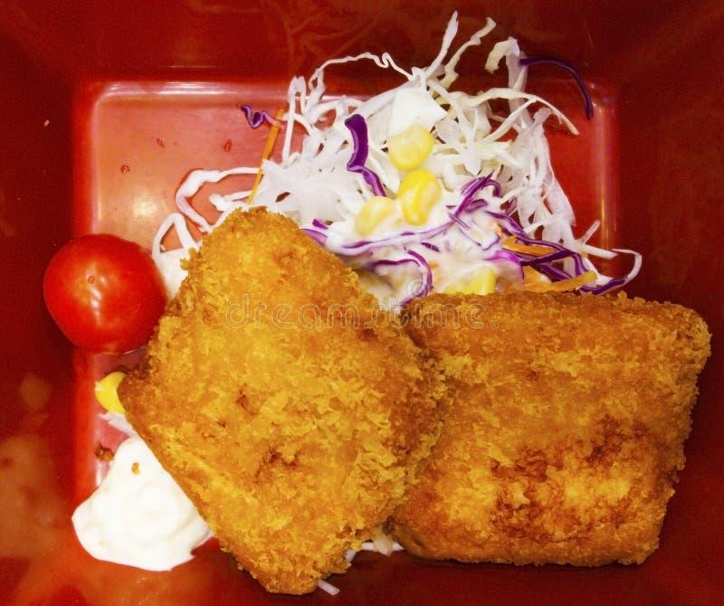 La comida japonesa, tonkutsu de los pescados, cortó pescados con pan y frió imágenes de archivo libres de regalías