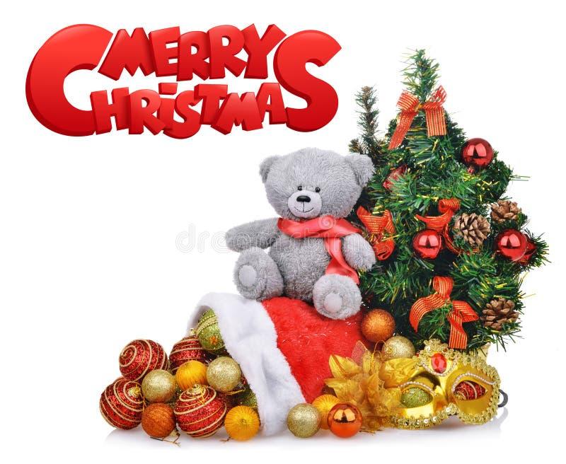 La composición con el árbol de navidad del oso de peluche y Papá Noel empaquetan fotografía de archivo