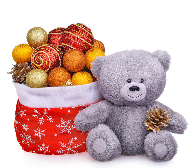La composición de la Navidad con el oso de peluche y Papá Noel empaquetan por completo de juguetes fotografía de archivo libre de regalías