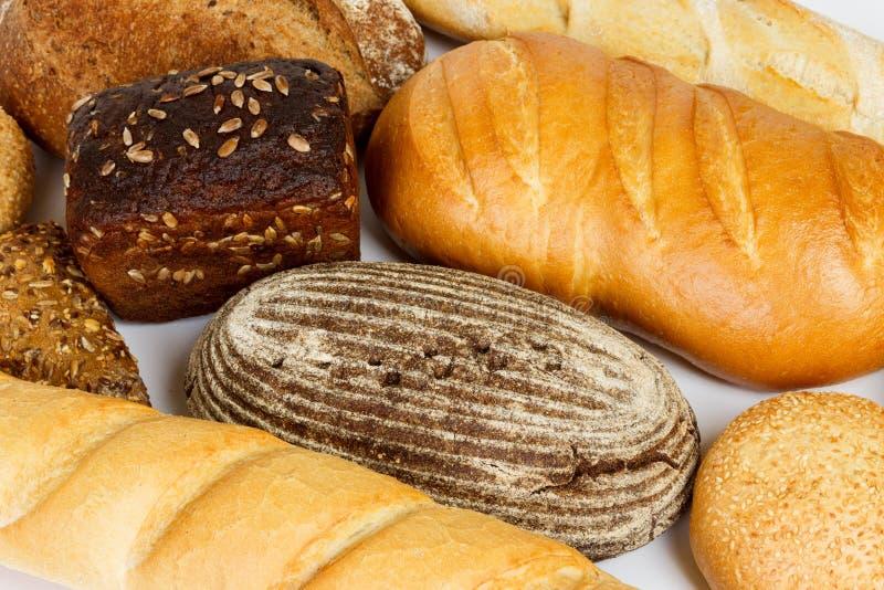 La composition avec du pain et les petits pains se ferment  photos stock