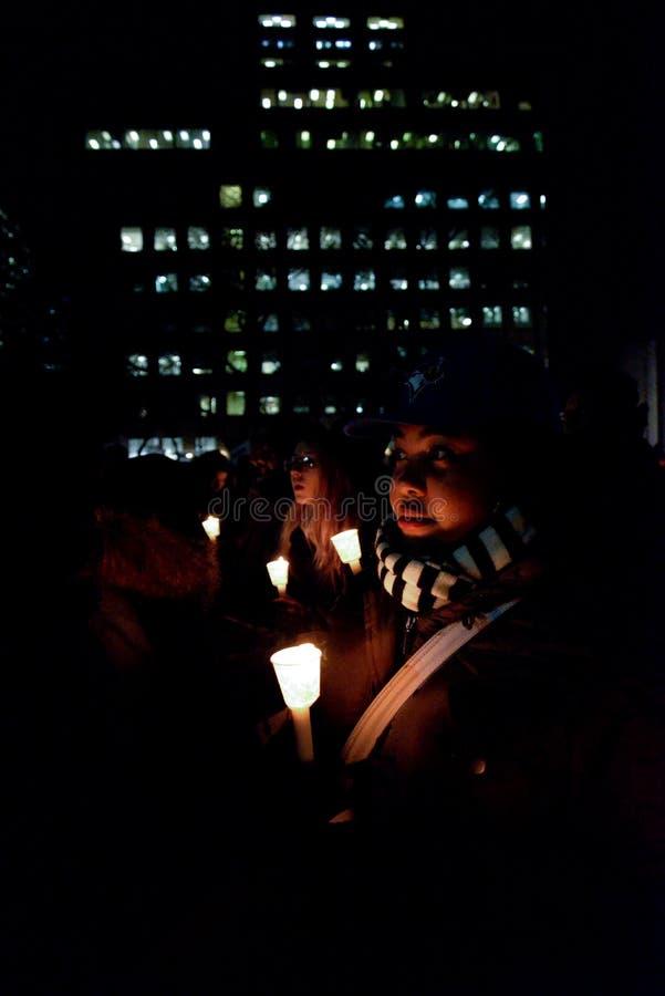 La comunidad negra de Toronto toma medidas en solidaridad con los manifestantes de Ferguson imagen de archivo