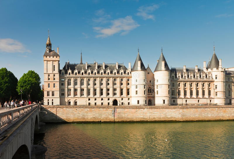 La Conciergerie, Paris, France. La Conciergerie - ex royal palace and prison over Seine river at summer day, Paris, France royalty free stock photos