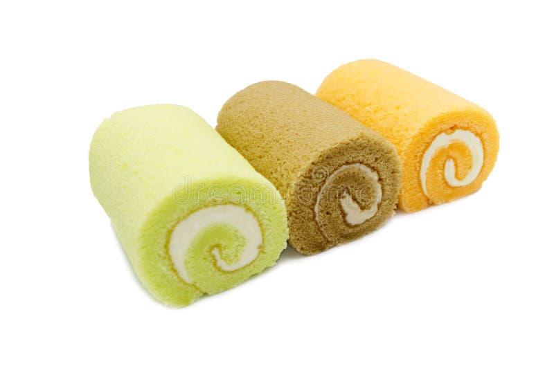 La confiture roule la couleur d'orange, de vert et de Brown de gâteau photographie stock