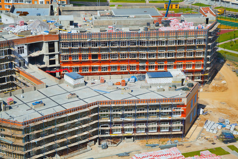 La construcción de nuevos edificios en el sitio fotografía de archivo libre de regalías