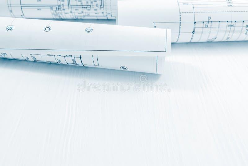 La construcción del arquitecto planea y blueprints con drawi técnico fotos de archivo