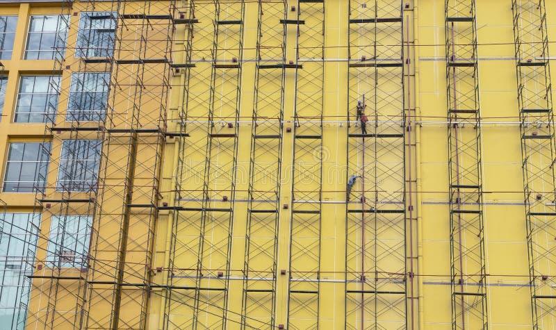 La construction de travail de travailleur dégrossissent photographie stock libre de droits