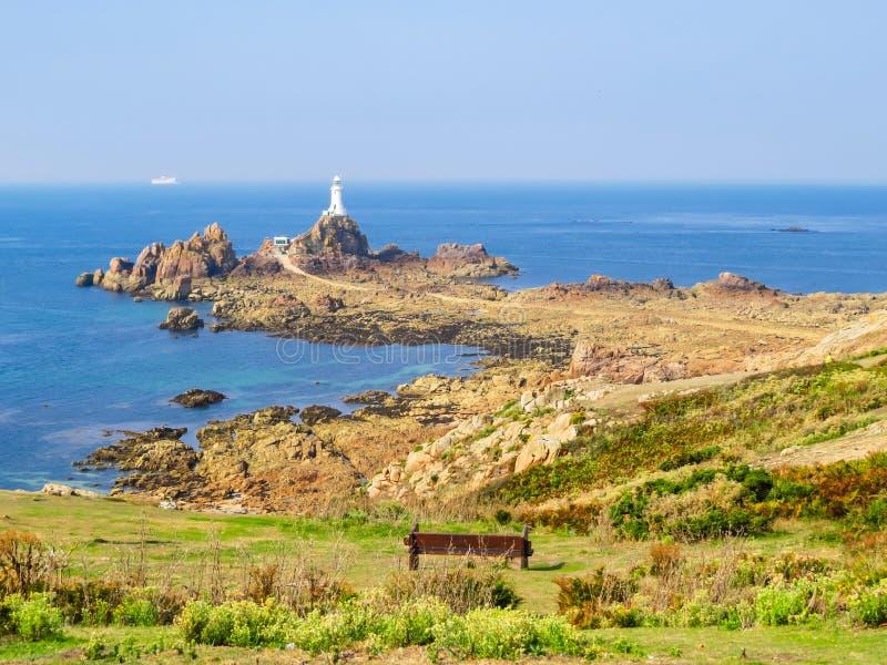 La Corbiere Lighthouse on the rocky coast of Jersey Island. Channel Islands royalty free stock image