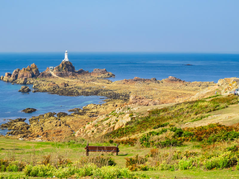La Corbiere Lighthouse on the rocky coast of Jersey Island. Channel Islands stock images