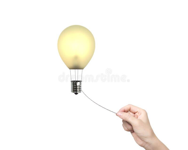 La corde de traction de main de femme a relié le ballon à air chaud d'ampoule photo stock