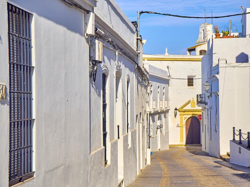 Vejer de la Frontera downtown. Cadiz province, Andalusia, Spain. La Corredera, a typical street of whitewashed walls of Vejer de la Frontera downtown, with royalty free stock photography