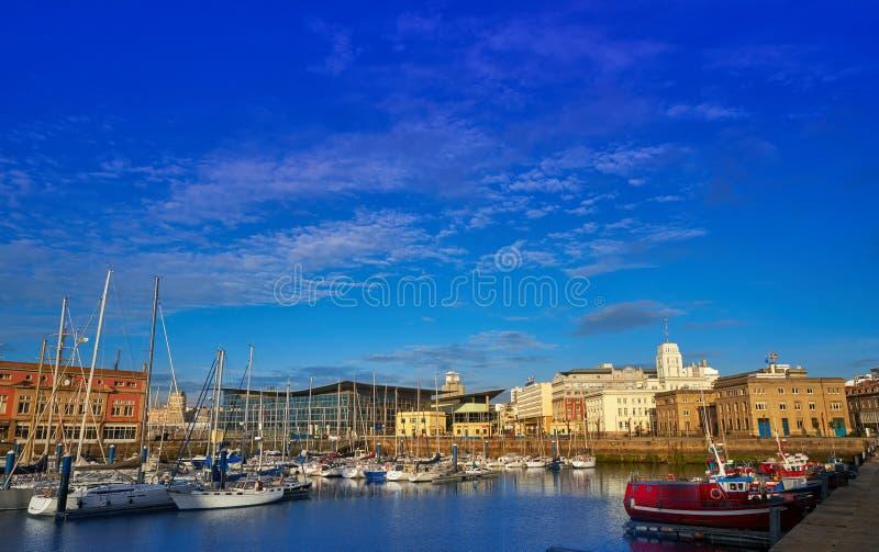 La Coruna Port in Galicia Spain. La Coruna Port sunrise in Galicia of Spain royalty free stock images