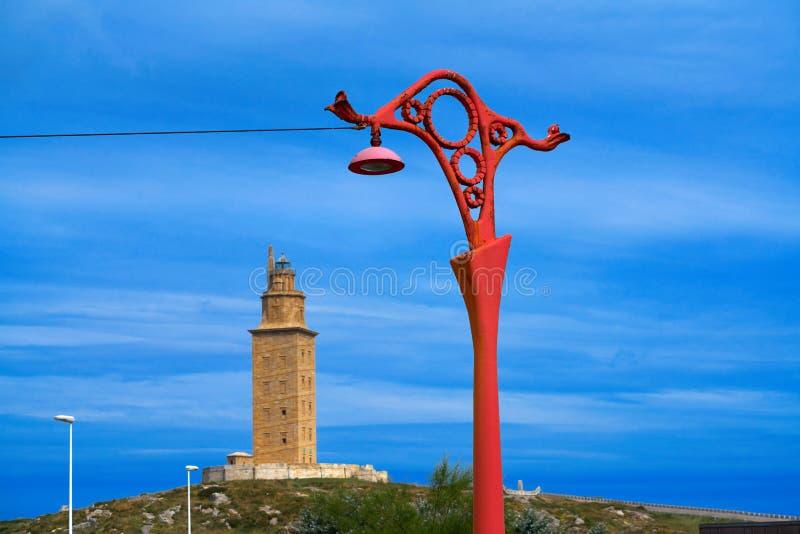 La Coruna red streetlights and Hercules tower Galicia. La Coruna red streetlights and Hercules tower in Galicia Spain royalty free stock photo