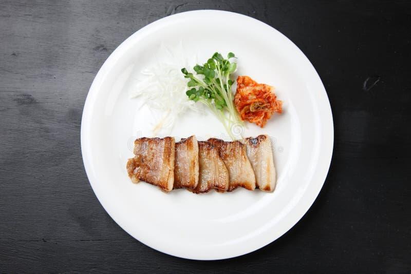 La costola di carne di maiale sottilmente affettata salta con il kimchi fotografia stock libera da diritti
