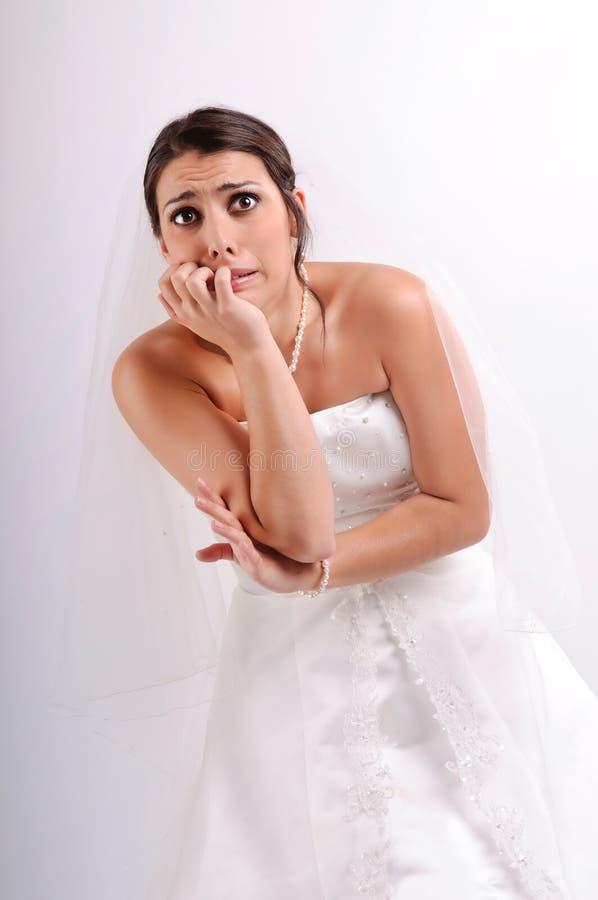 La crainte de la jeune mariée… image stock