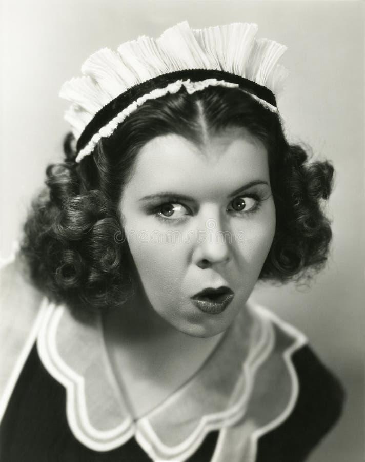 La criada entrometida imagen de archivo