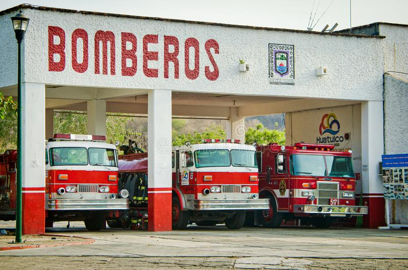 La Crucecita, Mexico - April 16, 2012. Fire fighter station with red cars royalty free stock photos