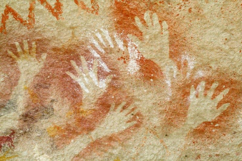 La cueva con la mano imprime, cueva de las manos fotos de archivo