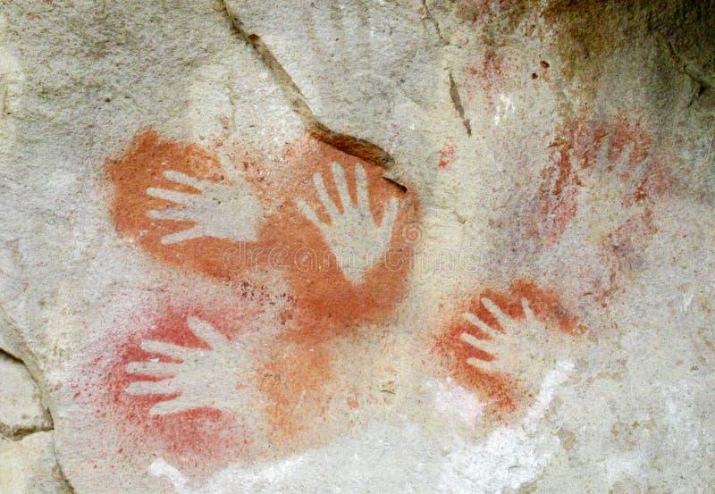 La cueva con la mano imprime, cueva de las manos imagen de archivo
