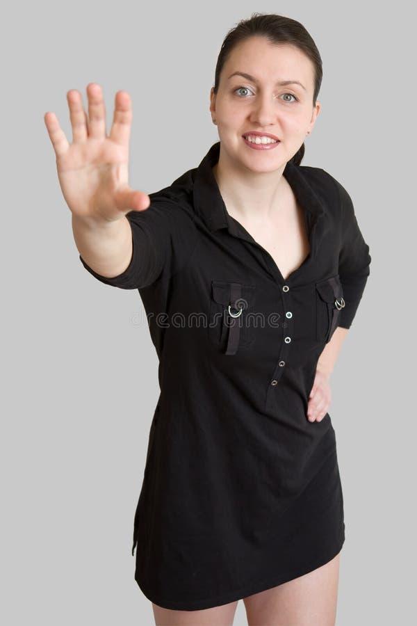 La dame d'affaires étire la main image libre de droits