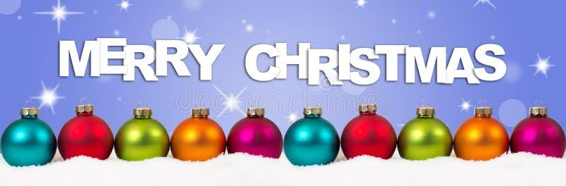 La decoración colorida de la bandera de las bolas de la Feliz Navidad protagoniza el backgroun fotografía de archivo libre de regalías