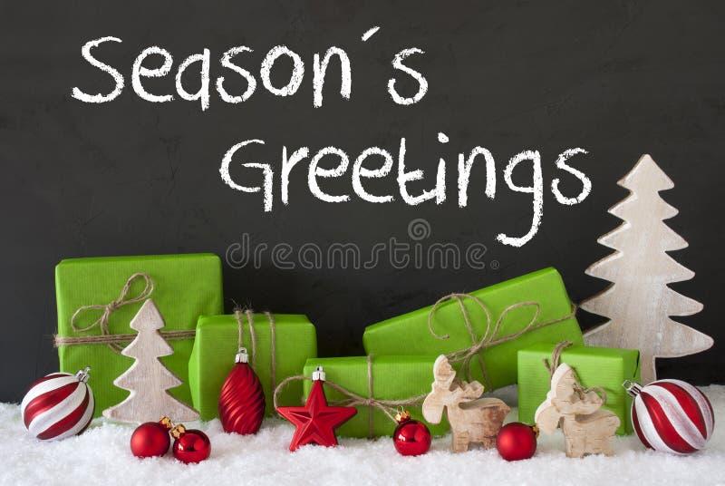 La decoración de la Navidad, cemento, nieve, texto sazona saludos imagen de archivo libre de regalías