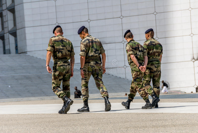 La defense, France - Mai 12, 2007: French military patrol assigned to the surveillance of a business district near Paris. These tr royalty free stock photo