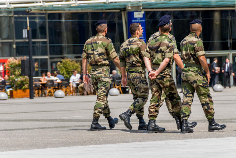 La defense, France - Mai 12, 2007: French military patrol assigned to the surveillance of a business district near Paris. These tr stock image