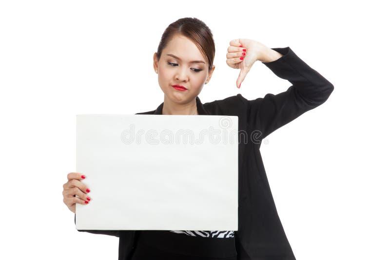 La demostración asiática joven de la mujer de negocios manosea con los dedos abajo con el espacio en blanco blanco si imágenes de archivo libres de regalías