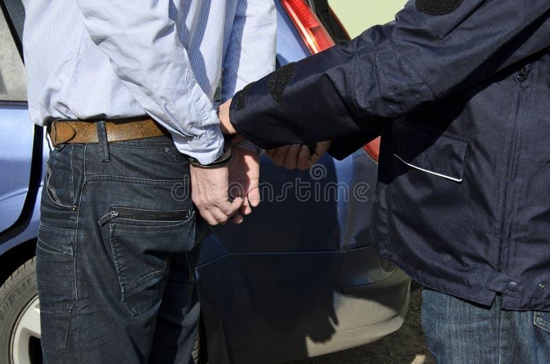 La detención de un hombre fotos de archivo