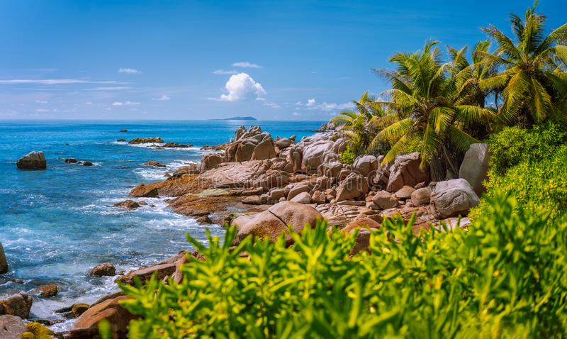 La Digue, Seychelles. Tropical exotic paradise like beach with granite boulders and coconut palm trees.  stock photography