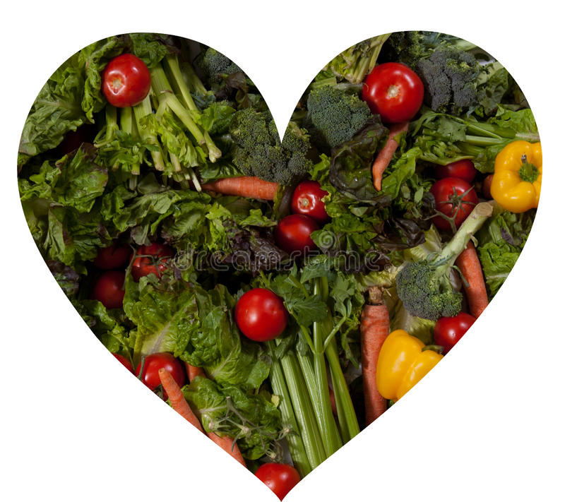 La dimensión de una variable del corazón llenó de las verduras frescas imagenes de archivo