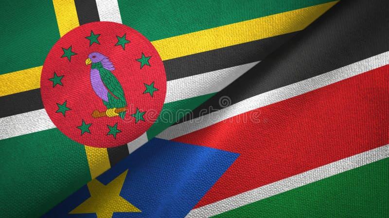 La Dominica e panno del sud del tessuto delle bandiere del Sudan due, struttura del tessuto fotografie stock libere da diritti