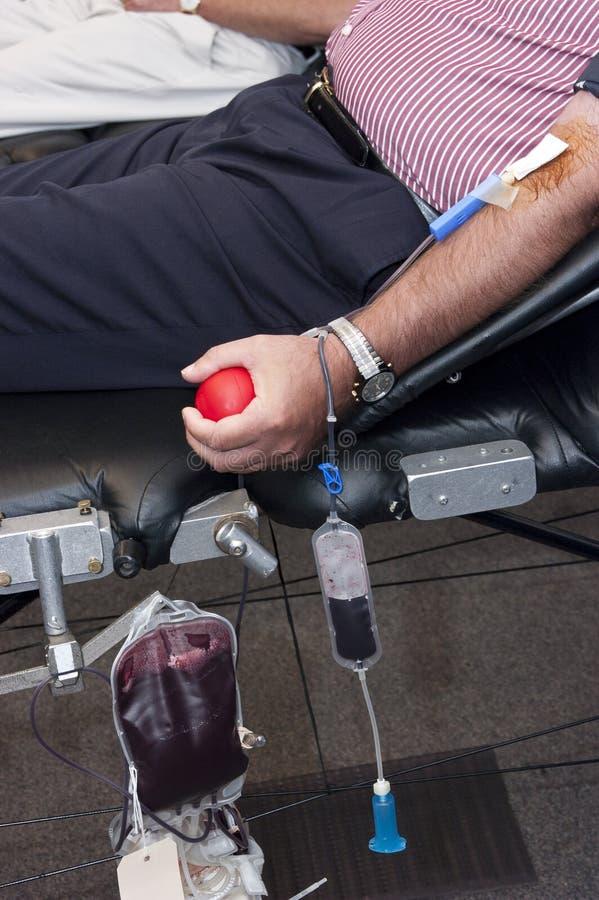 La donación de sangre, dona, la transfusión dispensadora de aceite médica fotografía de archivo libre de regalías