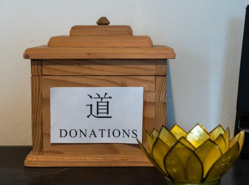 La donation incline la boîte image stock