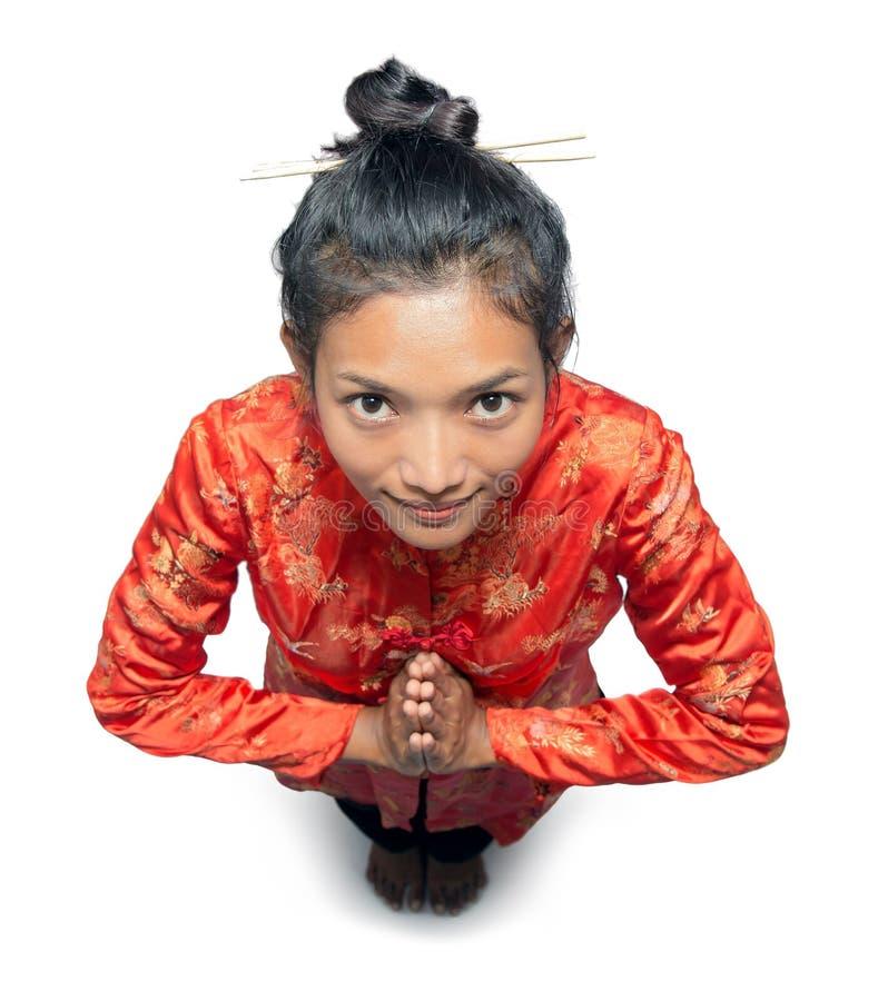 La donna asiatica accoglie immagine stock