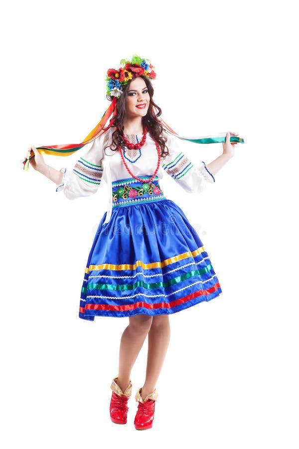 La donna attraente indossa l'ucranino blu di colore fotografia stock libera da diritti