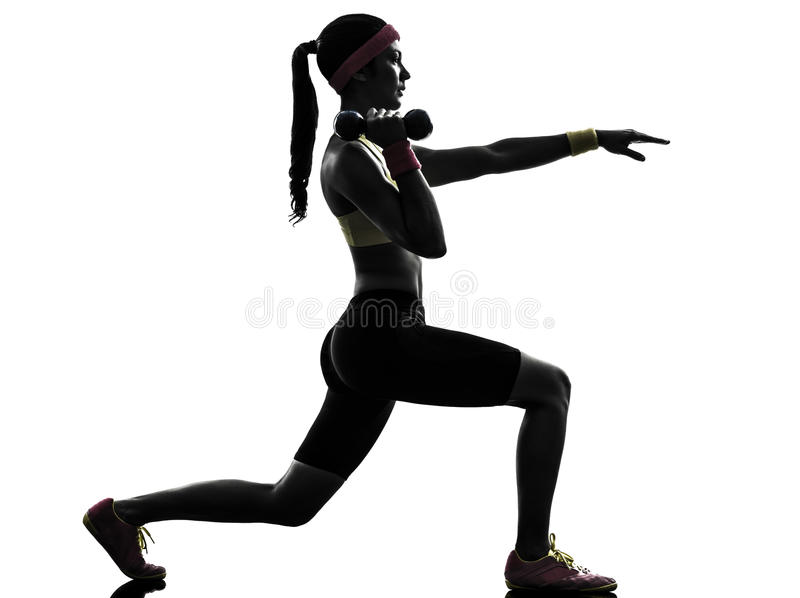 La donna che esercita la forma fisica dà una stoccata la siluetta di allenamento fotografia stock