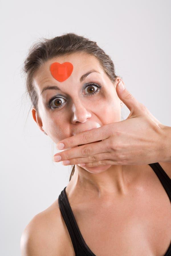 La donna con cosegna la bocca fotografie stock libere da diritti