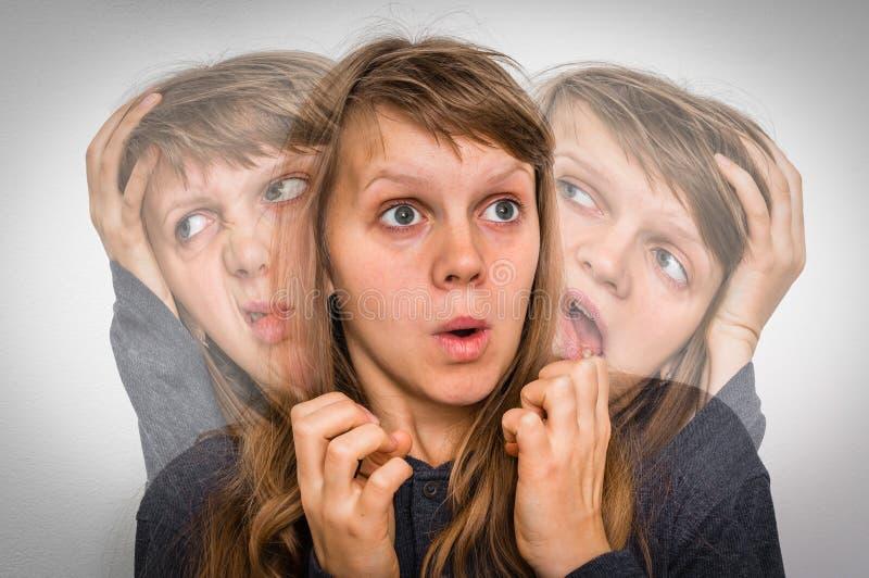La donna con sdoppiamento di personalita soffre dalla schizofrenia fotografie stock libere da diritti